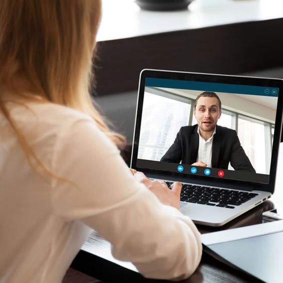 Women video conferencing on laptop
