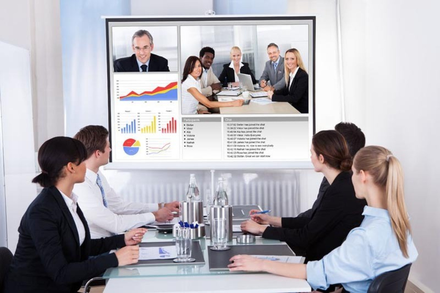 25514816 - businesspeople sitting in a conference room looking at screen